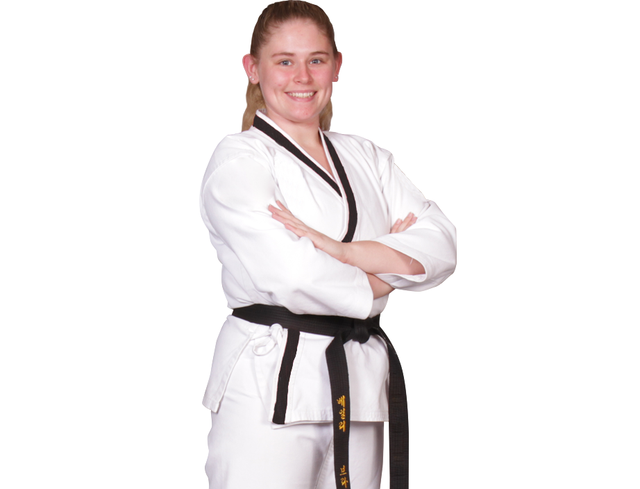 woman in a karate gi with arms crossed